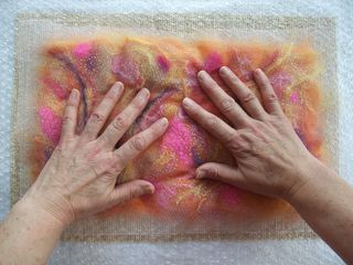 Applying soapy water to wool