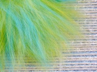 Third and final fringe of wool