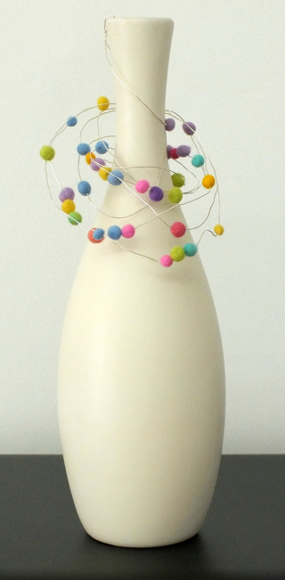 Tall vase with bead hanger