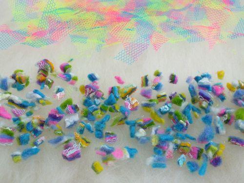 2. close up of felt scraps and net laid onto white merino