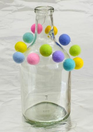 Glass vase with bead hanger