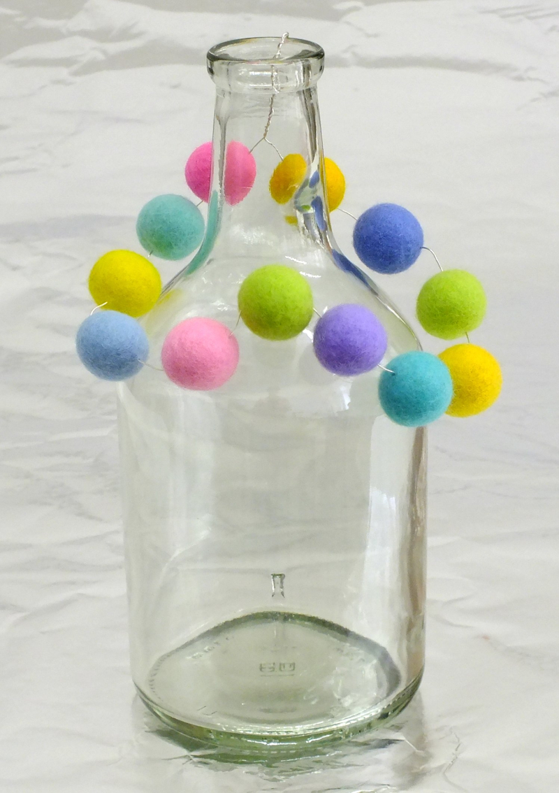 Glass vase with bead hanger