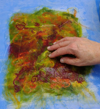 Work the paste into the silk fibres with your fingers