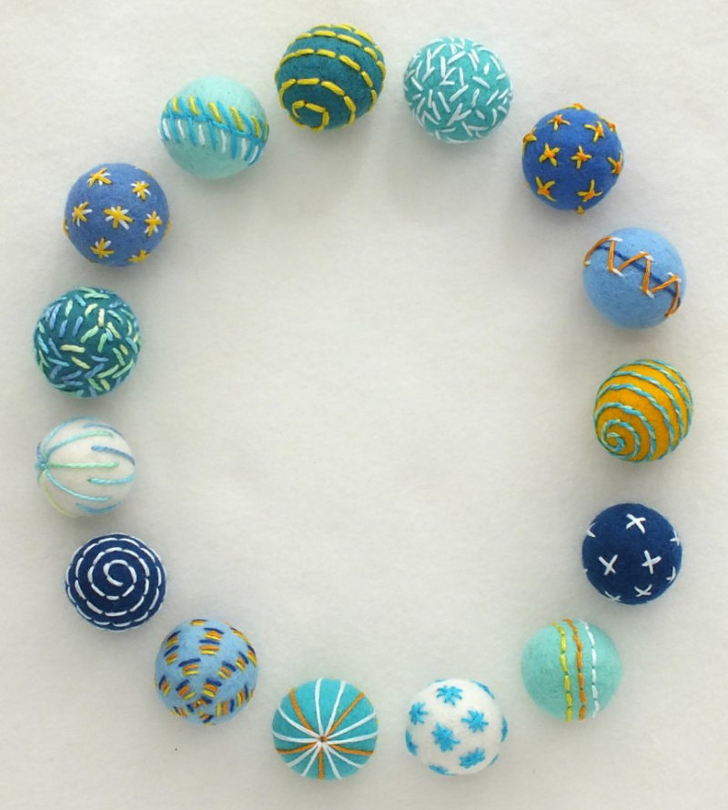 Embroidered felt beads