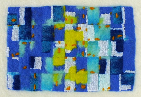 Cut felt re-felted onto loose white merino fibres